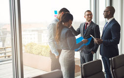 Multiethnic business team having a discussion Stock Photography