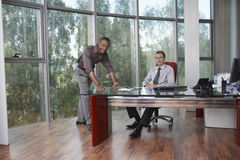 Multiethnic Businessmen At Office Desk Stock Image