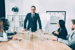 multiethnic businesspeople having conversation in modern stock photography