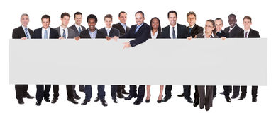 Multiethnic Businesspeople Holding Blank Billboard Royalty Free Stock Image