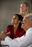 Multiethnic businesspeople looking up Stock Image