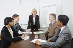Multiethnic businesspeople at meeting in conference room Royalty Free Stock Photo