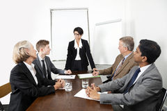 Multiethnic businesspeople at meeting in conference room Royalty Free Stock Photography