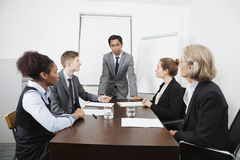 Multiethnic businesspeople at meeting in conference room royalty free stock image