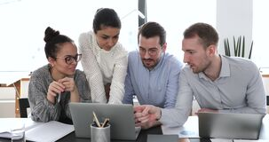 Multiethnic businesspeople working in office using computer discuss common project