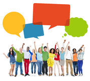 Multiethnic Cheerful People Celebrating with Speech Bubbles Stock Photo