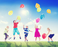 Multiethnic Children Outdoors Playing Balloons Stock Image