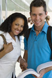 Multiethnic College Students With Book Stock Photos