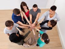 Multiethnic college students stacking hands Stock Photography