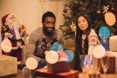 Multiethnic couple celebrating christmas Royalty Free Stock Photography