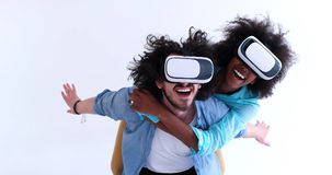 Multiethnic couple getting experience using VR headset glasses. Happy multiethnic couple getting experience using VR headset glasses of virtual reality, isolated Royalty Free Stock Photography