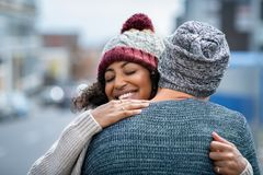 Free Multiethnic Couple Hugging Outdoor In Winter Stock Photography - 151999342