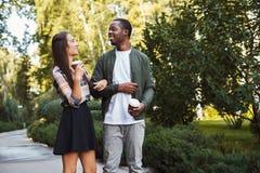 Multiethnic couple in love walk in park Stock Image