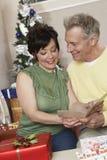 Multiethnic Couple Reading Greeting Card Stock Image