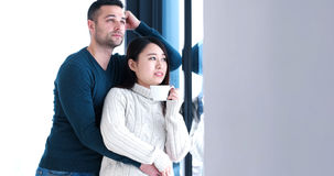 Multiethnic couple relaxing at modern home indoors Royalty Free Stock Photos