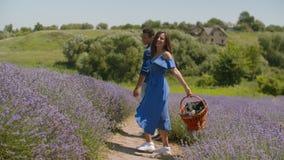 Multiethnic couple on romantic date in rural field stock video
