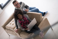 Multiethnic couple shopping online Stock Photography