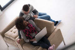 Multiethnic couple shopping online Royalty Free Stock Photos