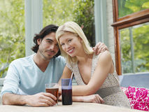 Multiethnic Couple At Verandah Table Royalty Free Stock Photos