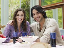 Multiethnic Couple At Verandah Table Stock Images
