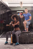 Multiethnic couple after workout with hammer Stock Photos