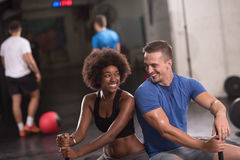 Multiethnic couple after workout with hammer Stock Photography