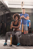 Multiethnic couple after workout with hammer Stock Image