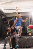 Multiethnic couple after workout with hammer Royalty Free Stock Photo