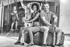 Multiethnic couple after workout with hammer Stock Images