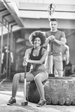 Multiethnic couple after workout with hammer Royalty Free Stock Photos