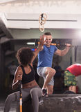 Multiethnic couple after workout with hammer Royalty Free Stock Photography