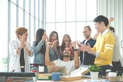 Multiethnic diverse asian college group celebrate win success with team feeling happy. Asian young creative team engaged together. In office party with small stock photography