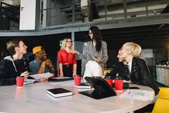 Multiethnic diverse group of happy colleagues working together. Creative team, casual business coworker, or college stock images