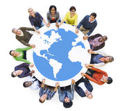 Multiethnic Diverse People in a Circle Holding Hands Stock Photography