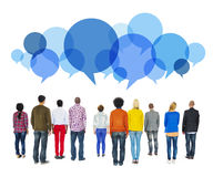 Multiethnic Diverse People Facing Backwards with Speech Bubbles Royalty Free Stock Images