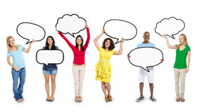 Multiethnic Diverse People Holding Blank Speech Bubbles Stock Photo
