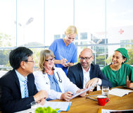 Multiethnic Doctors Meeting At Hospital Stock Images