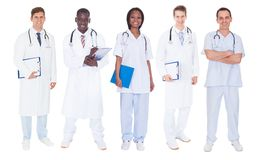 Multiethnic doctors over white background Stock Image