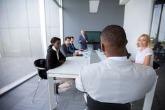 Multiethnic employees at meeting stock photography