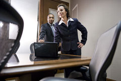 Multiethnic executives in boardroom. Hispanic businesswoman and African American businessman meeting in conference room royalty free stock photos