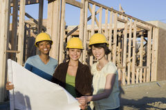 Multiethnic Female Architects Holding Blueprint Royalty Free Stock Photo