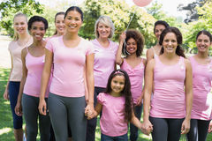 Multiethnic females supporting breast cancer awareness Royalty Free Stock Photos