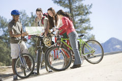 Multiethnic Friends With Bikes And Map Stock Photo