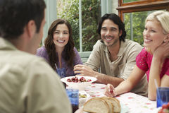 Multiethnic Friends Enjoying At Verandah Table Royalty Free Stock Image