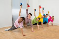 Multiethnic Friends Exercising. Diverse Multiethnic Group Of Fit Friends Exercising Together royalty free stock photo