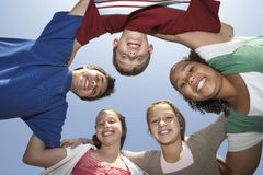 Multiethnic Friends Forming Huddle Stock Image