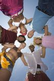 Multiethnic Friends Forming Huddle Stock Photo