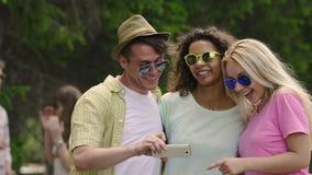 Multiethnic friends having fun together, posing for selfie, enjoying happy life