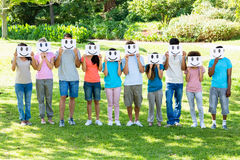 Free Multiethnic Friends Holding Smileys In Park Stock Photos - 39219723