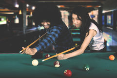 Multiethnic friends playing billiard Royalty Free Stock Photography
